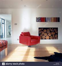 Red Leather Armchair With Pedestal Foot Beside Modern Alcove Stock ... Chairs Red Leather Chair With Ottoman Oxblood Club And Brown Modern Sectional Sofa Rsf Mtv Cribs Pinterest Help What Color Curtains Compliment A Red Leather Sofa Armchair Isolated On White Stock Photo 127364540 Fniture Comfortable Living Room Sofas Design Faux Picture From 309 Simply Stylish Chesterfield Primer Gentlemans Gazette Antique Armchairs Drew Pritchard For Sale 17 With Tufted How Upholstery Home