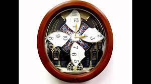 QXM478BRH Seiko Melodies In Motion Pendulum Wall Clock