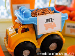 A Boy Turns 2 & We Throw A Themed Birthday Party - Intentional ... Mud Trifle And A Dump Truck Birthday Cake Design Parenting Diy Awesome Party Ideas Pinterest Truck Train Cookies Firetruck Dump Kids Cassie Craves Dirt In Cstruction With Free Printable Shirt Black Personalized Stay At Homeista Invitations Dolanpedia The Mamminas A Garbage Ideal For Anthonys Our Cone Zone