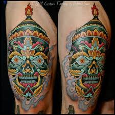 Colorful Tibetan Skull With Smoke Flame Tattoo