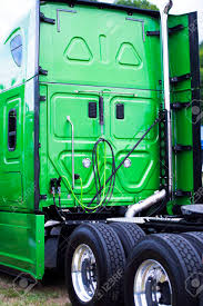 A Big Green Modern Rig Semi Truck With A High Cabin With Flat ...