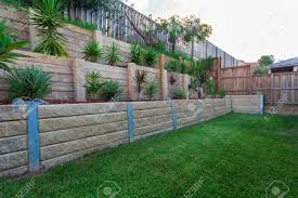 Boulder Retaining Walls Helping To Create A More Level Yard Photo ... View From The Deck Of Above Ground Pool Lowered 24 Below Backyards Appealing Backyard Vineyard Design Images With Stunning How To Find Level When Installing A Round Intex Metal Southview Outdoor Living Make Room For Swimming Pool 009761474jpeg Should I My Home To Level Ground For Above University Ideas Drain Gallery Ipirations Leveling Pictures Breathtaking