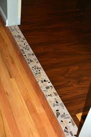 Accent Tile Transition Between The Hardwood In Dining Room And Vinyl Planking