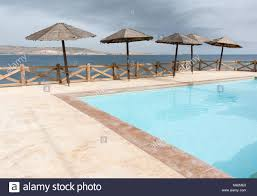 100 Wooden Parasols An Image Of Wooden Parasols Around A Swimming Pool With The