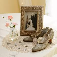 Reception Decor Of The Brides Grandmothers Wedding Photo And Her Vintage Bridal Shoes