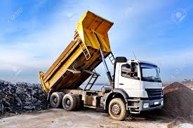 100 Dump Trucks Videos A Truck Is Ing Gravel On An Excavation Site Stock Photo
