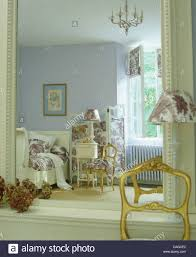 Mauve Bedroom by Gilt Chair Beside Painted Mirror With Reflection Of Mauve Bedroom