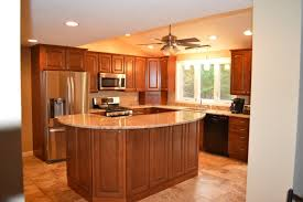 L Shaped Kitchen With Tier Island Dark Wooden Cabinets Luxurious Granite Countertop Expensive Stainless