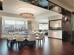 Circular Dining Table With Chandelier Above In Modern Room