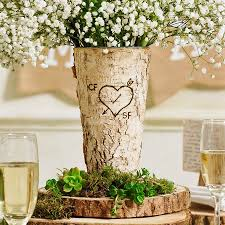 This Country Wedding Table Looks Charming With Flowers Placed Over Wooden Slices