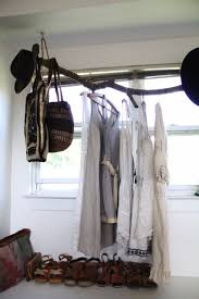 Use Branches To Make Fantastic DIY Clothes Rack That Costs Next