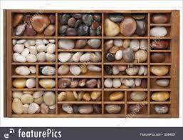 100 River House Decor Pebbles In Typesetter Drawer Stock