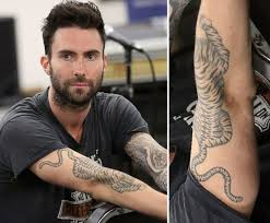 Adam Levine Has A Tattoo Sleeve On His Left Arm And Large Tiger Design Placed