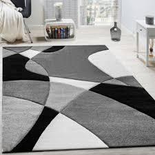 ثلاثة تغلب رباعي السطوح tapis blanc noir