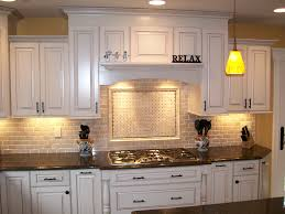 White Wooden Kitchen Cabinet With Black Counter Top And Stove Also