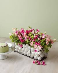 Create A Centerpiece With Flowers And Eggs