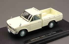 100 Datsun Truck EBBRO EB44690 DATSUN TRUCK 1300 1966 IVORY 143 MODELLINO DIE CAST