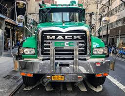 New York, January 12, 2017: A Green Powerful Garbage Truck Is ... Daesung Max Dump Truck Toy Model Flywheel Green Color 33 X 13 15 Garbage Truck Videos For Children L Blue Bruder Toys 116 Man Wtrash Bins Bta02764 Man Tgs Rear Loading Garbage Truck Green Farming With Slogan Thing Think Clean Carlsbad Ca Week 1 Youtube Buy Rear Loading 03764 Close Look At Tonka Worlds Best Us Recycling Waste Management Adding Cleaner Naturalgas Vehicles Houston Jadrem Bruder Rearloading Greenyellow