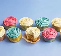 A Selection Of Iced Cupcakes