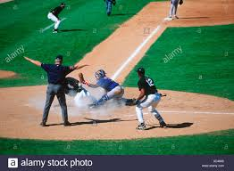 Sliding in safe at home plate spring training baseball game at
