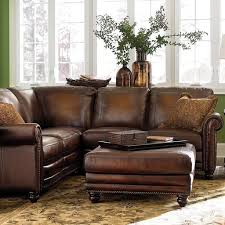 Brown Leather Couch Living Room Ideas by Green Wall Color And Floral Carpet For Charming Living Room Ideas