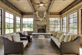 Rustic Sunroom Decorating Ideas With Stone Fireplace Wood Ceiling