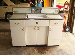 Simple Antique Metal Kitchen Hutch Featuring Uneven Front Cabinet Surface With Knob White Countertop Fitted Sink