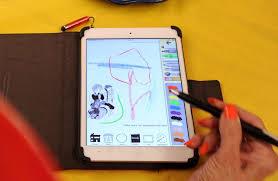 Art Teacher Susan Striker Displays Her Anti Coloring Book App On IPad At The