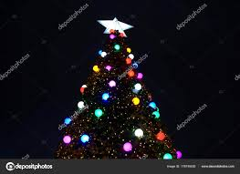 A Christmas Tree With Bright Lights Outdoor Photo By Mrkarltapalesyahoo