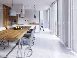 beautiful white dining room with a large table and designer chairs stock photo image now