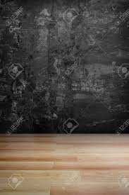 Dark Grey Grungy Concrete Wall And Wooden Floor Use For Background Stock Photo