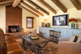 Rustic Living Room With Tv And Wicker Baskets In Modern Media Console Wood Ceiling Beams Beige Wall Plus Concrete Fireplace Leather Sofa