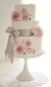 White Lace Wedding Cake With Pink Roses And Gray Ribbon