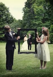 ❤ Max and Landon holding a frame Wedding pics