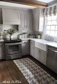 Gray Painted Kitchen Cabinets With Marble Countertops And Wood Floor Soft Subtle