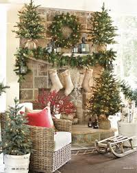 Rustic Christmas Mantelwith Trees Wrapped In Burlap And Stockings Hanging From The Fireplace DecorationsRustic