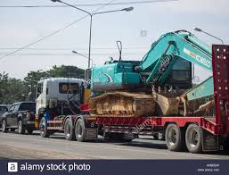 CHIANG MAI, THAILAND -JANUARY 8 2018: Trailer Dump Truck And Backhoe ... Trucking And Transport Company Lithonia Derrick Pugh Inc Barnish Companies Dumpsters Mulch Delivery Double Run Brokerage Delivering Coal More Ephrata Pa Extreme Trailer Llc Introduces Xd Heavy Duty Dump Keith Day Compygabilan Ag Services The 44 Historical Photos Of Detroits Fruehauf Companythe Mts Belt Vs End Dumps Youtube Welcome Trantham Used 2004 Ravens Tri Axle For Sale 563048 Side Demolition Trailers Kline Design Texas