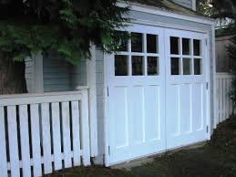 Hand made custom carriage garage doors and REAL Carriage House