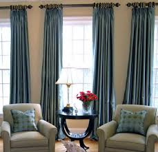 Wonderful Family Room Design With Beautiful Light Blue Loft Window Coverings And Comfortable Grey Sofa