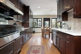 This Parallel Kitchen Layout Uses The Light To Prevent Narrow And Dark Room From Becoming