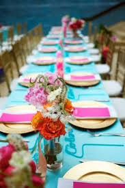 teal and fuchsia reception table decor
