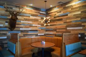 Banquets And Reclaimed Wood Accent Walls The Seventh Ward ~ Arafen Rustic Ranch Style House Living Room Design With High Ceiling Wood Diy Reclaimed Barn Accent Wall Brown Natural Mixed Width How To Fake A Plank Let It Tell A Story In Your Home 15 And Pallet Fireplace Surrounds Renovate Your Interior Home Design With Best Modern Barn Wood 25 Awesome Bedrooms Walls Chicago Community Gallery Talie Jane Interiors What To Know About Using Decorations Interior Door Ideas Photos Architectural Digest Smart Paneling 3d Gray