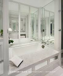 Tiling A Bathtub Deck by Mirrored Bathtub Transitional Bathroom Lichten Craig Architects