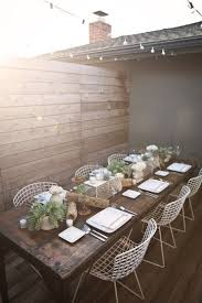 Wouldnt This Be A Beautiful Space For An Outdoor Dinner Party With Frineds I Love The Heavy Rustic Table Paired White Wire Chairs
