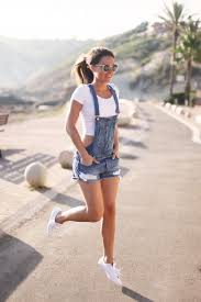 Busy Days Call For A Simple Yet Stylish Outfit Such As White Cropped Top And Blue Denim Overall Shorts Complement This Look With Low Sneakers