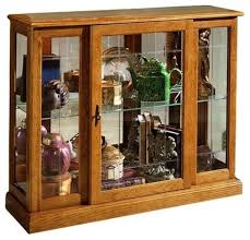 Pulaski Concave Corner Curio Cabinet by Pulaski Furniture Golden Oak Mirrored Curio Console Transitional