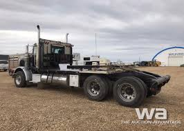1999 PETERBILT 378 T/A TEXAS BED WINCH TRUCK