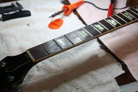 BEFORE The Fretboard On A 69 Les Paul Deluxe Before Reconditioning You Can See Ruts Of Wear First Three Frets Have Already Been Pulled
