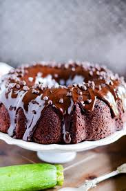 Rich and moist chocolate zucchini cake with chocolate chips and a decadent chocolate ganache on top