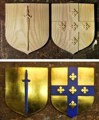 these are two small family coat of arms origins in scotland on